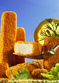 Fish fingers, one on fork