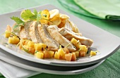 Chicken fillet with marinated fruit and baked potatoes