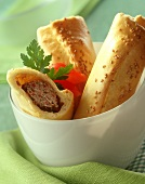 Mince rolls in pastry with sesame