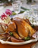 Guinea-fowl with pears on large plate