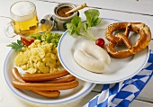 Vienna sausages & potato salad; white sausages & pretzel; beer