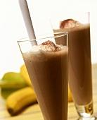 Chocolate shakes with cream; bananas