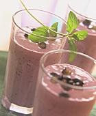 Blueberry milkshake with sprig of fresh mint