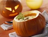 Pumpkin soup with pumpkin seeds for Halloween