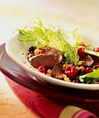 Curly endive with berries, venison medallions & walnuts