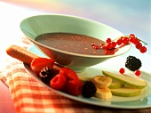 Chocolate fondue with fruit and sponge fingers