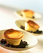 Small soufflés on blueberry compote