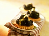 Blackberry tartlets with balsamic whip and pistachios