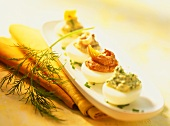 Stuffed eggs, garnished with sprig of dill