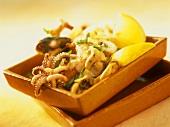 Seafood salad with lemon wedges