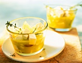 Pickled sheep's cheese with lemons and herbs