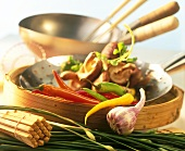 Asian vegetables, bamboo steamer and wok