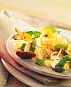 Tagliatelle with Asian vegetables, cream sauce & edible flowers