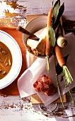 Goulash soup with ingredients (vegetables, meat, bay leaf)