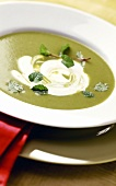 Creamed pea soup with fresh mint and crème fraiche