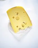 Piece of Emmental cheese on paper
