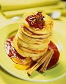 Pancakes with peach and plum sauce and cinnamon