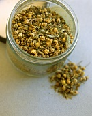 Dry camomile tea in jar