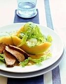 Salad with melon and duck breast