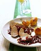 Pork fillets with cranberry sauce and roast potatoes