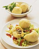 Stuffed potato dumplings on savoy