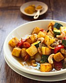 Potato curry with courgettes and cashew kernels