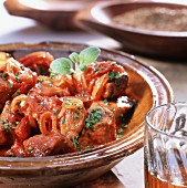Lamb ragout with tomatoes, onions and herbs