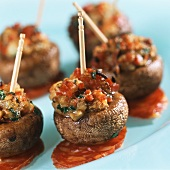 Stuffed mushrooms with chorizo on cocktail sticks