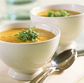 Peanut soup with carrots and fresh cress