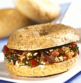 Sesame ring with aubergine and tomato salad