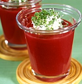 Spicy beetroot soup with cress cream in glasses