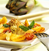 Pan-cooked potato and artichoke dish with cherry tomatoes