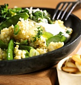Spring millet risotto with green vegetables, cress & yoghurt