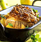 Roast pork with marjoram and apples in roasting dish