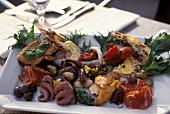 Antipasti platter with seafood, sausage etc