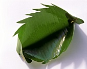 Banana leaf bowl with jagged edges