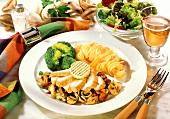 Chicken breast with mushroom ragout, noodles, broccoli & salad
