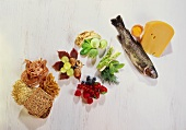 Still life: wholemeal foods, vegetables, berries, fish, cheese