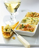 Shrimps, crab- and fish paste with toast, glass of white wine