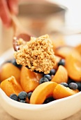 Breakfast mix with peaches, blueberries, cereal flakes