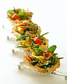 Small vegetable tarts in baking tins