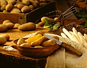 Still life with boiled potatoes and white asparagus