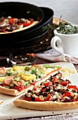 Pizza with mince and Hawaiian topping for a pizza party