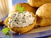 Pumpkin roll with cheese spread and fresh parsley