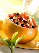 Grapefruit stuffed with oat flakes and blueberries