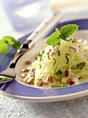 Raw kohlrabi salad with mustard dressing and sunflower seeds