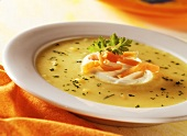 Potato soup with salmon and sour cream on plate
