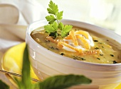 Potato soup with salmon and sour cream in soup bowl