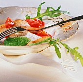 Pesce con salsa di rucola (fish with rocket sauce and tomatoes)