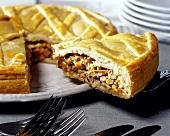 Chicken and sweetcorn pie, a piece cut